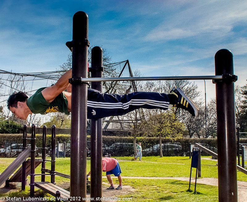 Stefan Lubomirski doing the back lever, a difficult bodyweight exercise