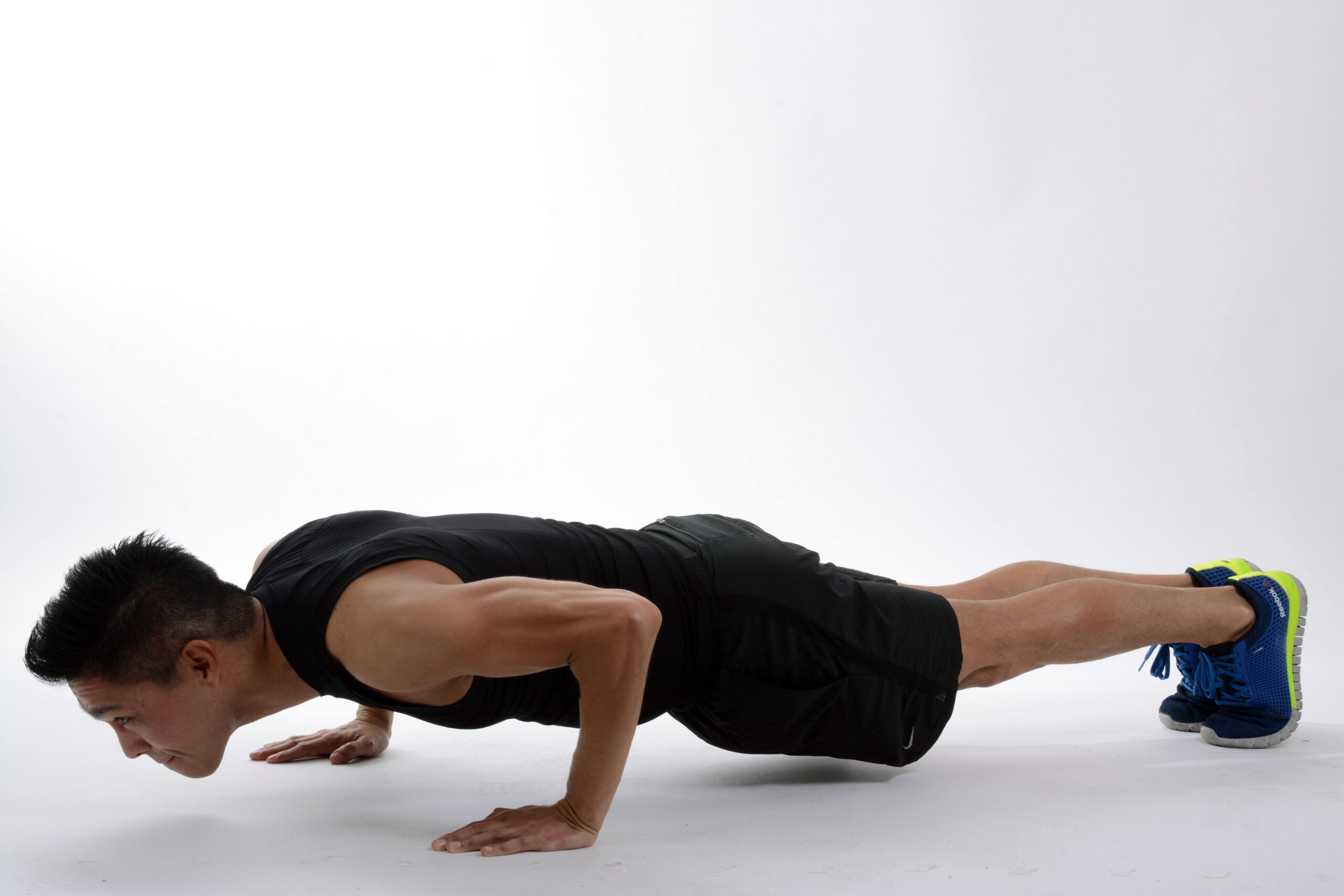 Picture of a man in the bottom position of a push-up