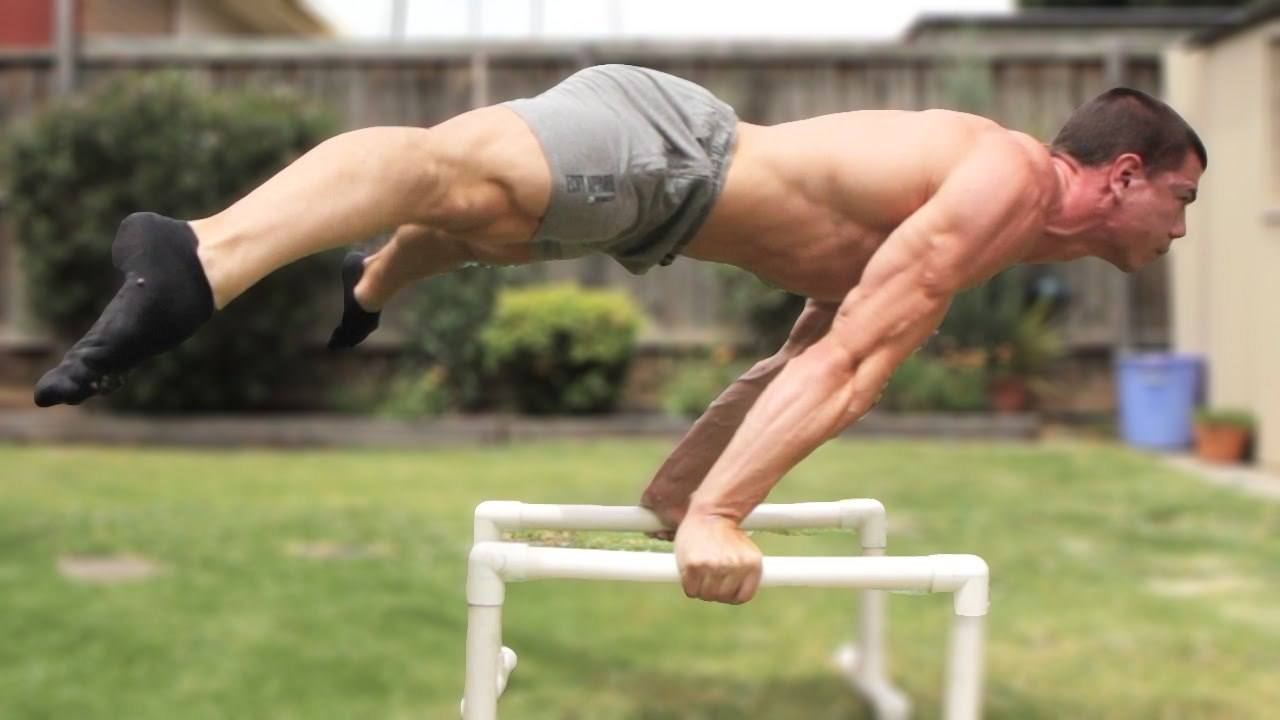 Daniel Vadnal from FitnessFAQs performing the straddle planche