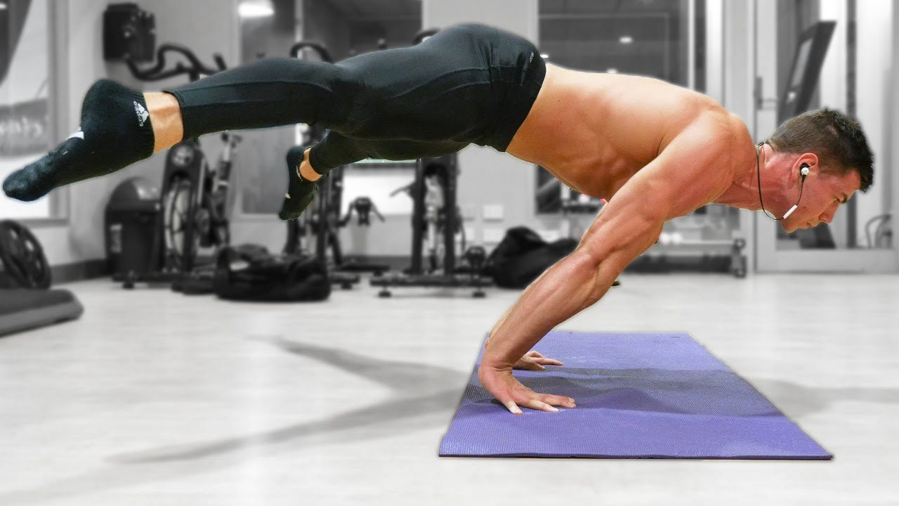 Daniel Vadnal from FitnessFAQs performing the straddle planche exercise