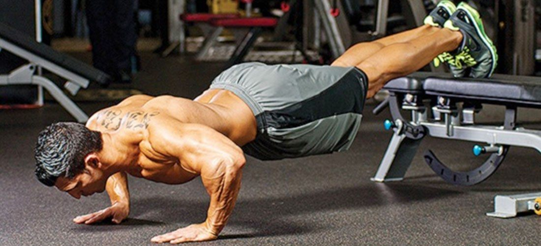 Man doing decline push ups for his shoulder workout