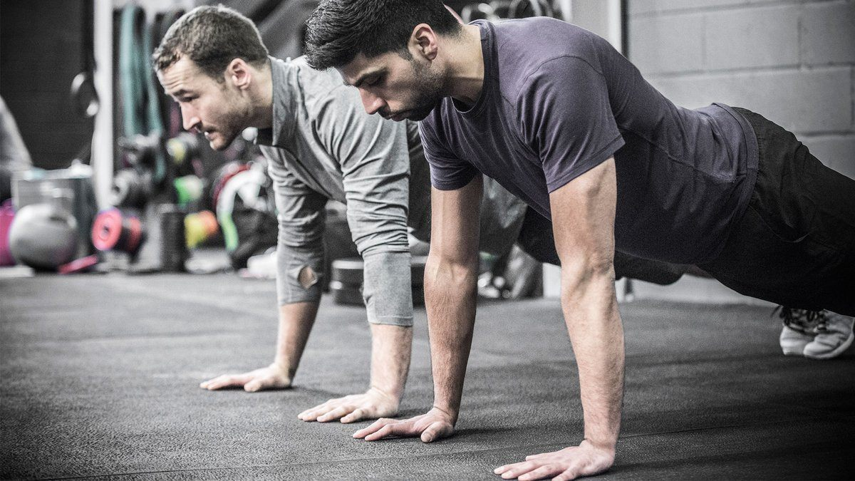 Picture of two men doing push-ups as part of their calisthenics workout