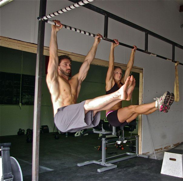 Man and woman at the bottom position of an L pull up
