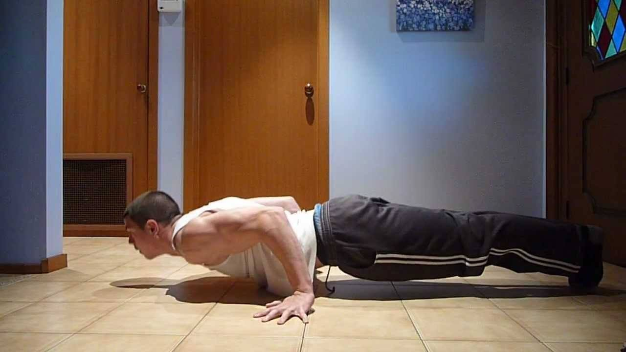 Daniel Vadnal doing pseudo planche push-ups for his bicep development