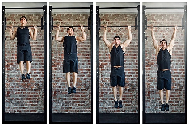 Man learning how to do a pull-up by doing eccentric pull-ups