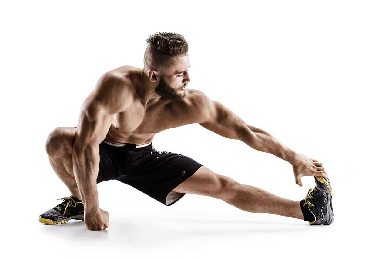 Picture of an athlete stretching his hamstrings
