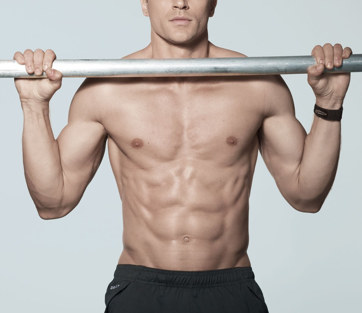Ripped athlete showing that the best pull-up bar is the one that you train on