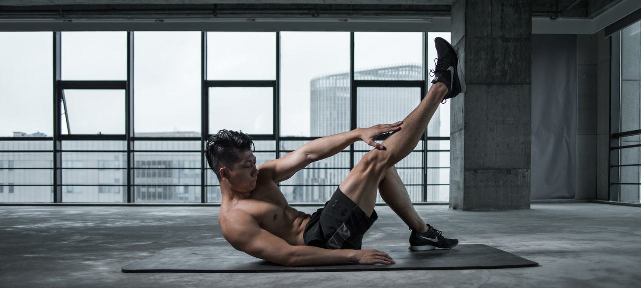 Athlete doing crunches as part of his core training