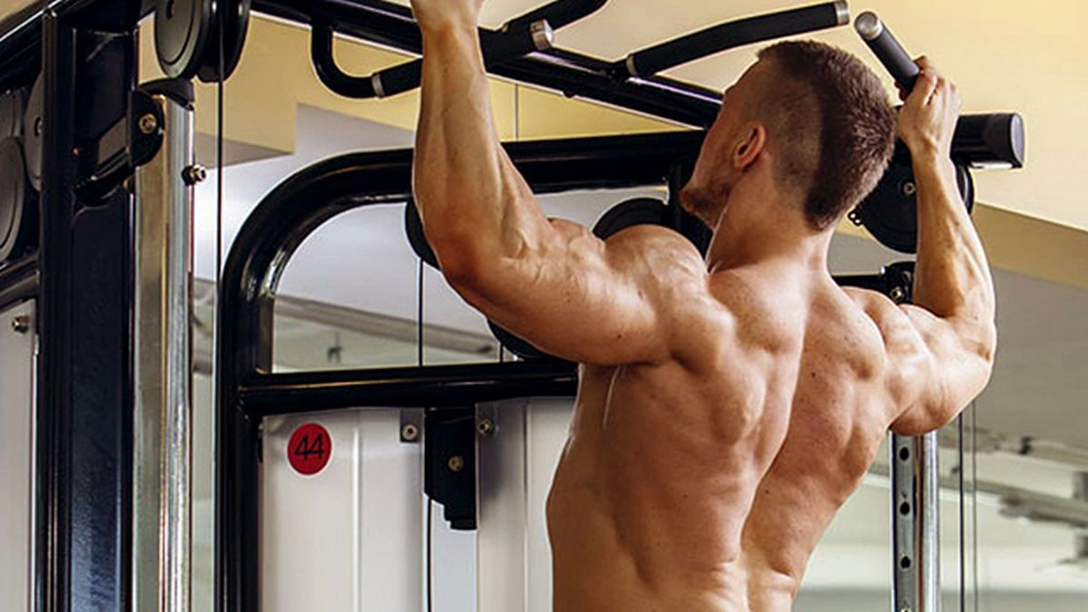 Man doing pull-ups to reap the benefits they have to offer