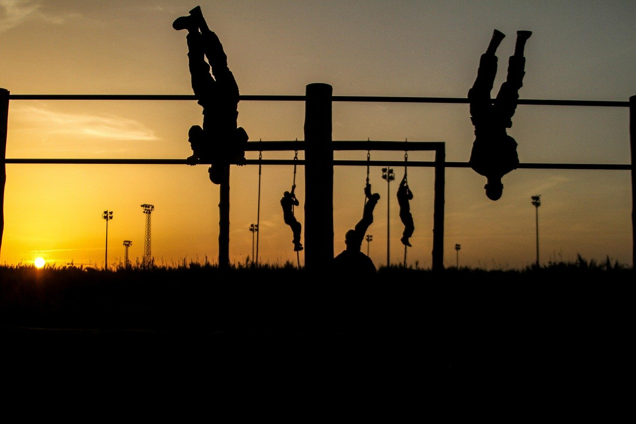 Picture showing military men doing a calisthenics workout at sundown