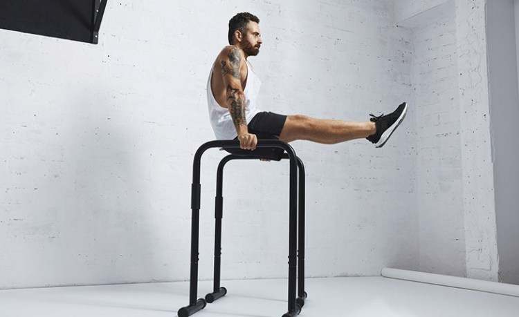 Athlete doing a full L-sit on parallel bars