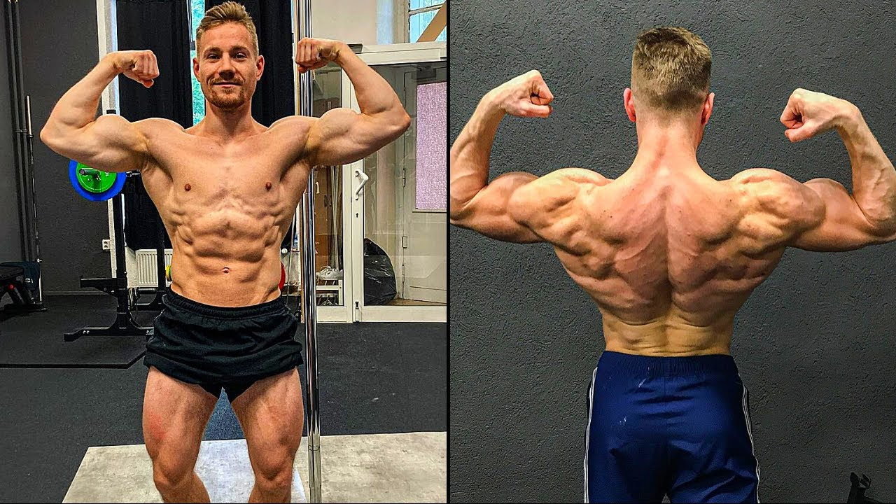 Micha Schulz flexing his anterior chain and back muscles