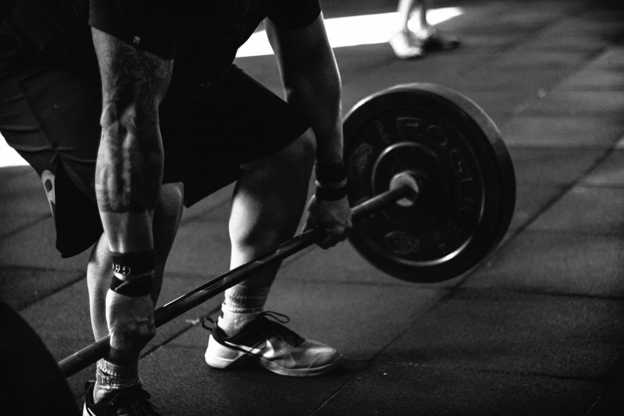 Black and white picture of a man doing deadlifts